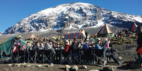 Students enjoying a meal on Mt Kilimanjaro